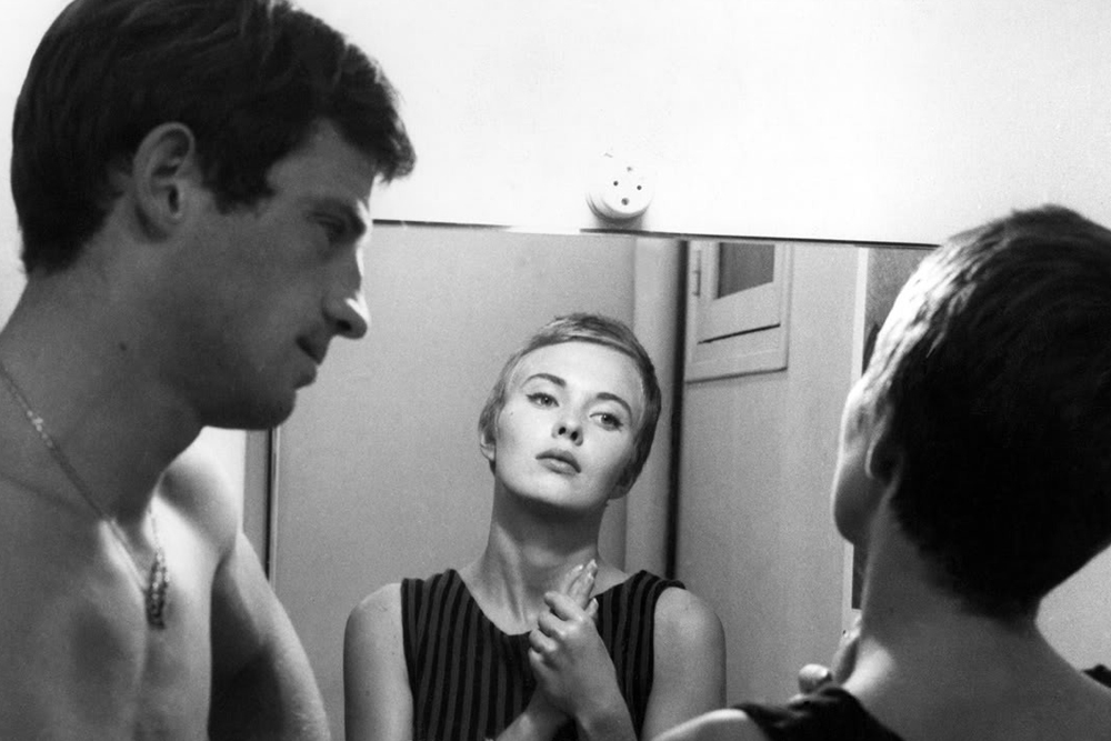"Lindsay Film Review | Breathless (À Bout de Souffle): Jean-Luc Godard's New Wave Ode to Youth | Jean-Paul Belmondo as Michel Poiccard and Jean Seberg as Patricia Franchini in ""Breathless,"" (1960)"